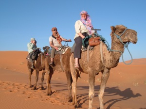 People (not me) on camels in the Sahara Desert (www.saharaatlastours.com)